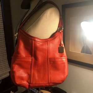 Coral leather tote bag with gold accents